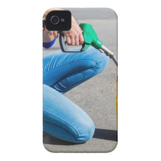Woman filling yellow can with gasoline or petrol. iPhone 4 Case-Mate case