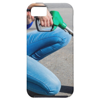 Woman filling yellow can with gasoline or petrol. iPhone 5 case