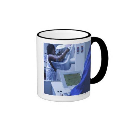 Woman getting mammogram mug