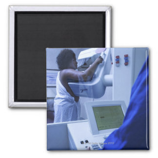 Woman getting mammogram square magnet