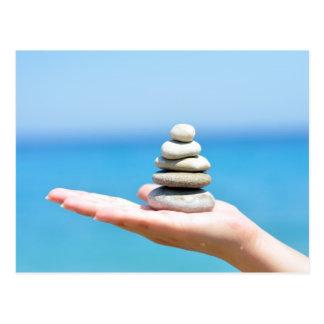 woman hand zen stones sea ocean summer postcard
