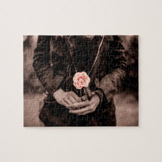 Woman Holding a Pink Camellia Puzzles