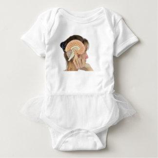 Woman holding hemisphere model  against head baby bodysuit
