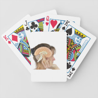 Woman holding hemisphere model  against head bicycle playing cards