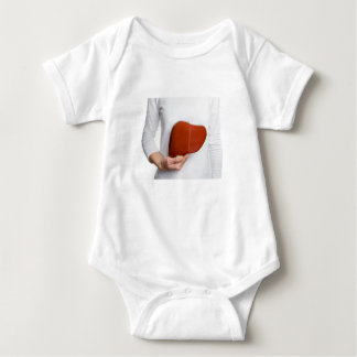 Woman holding human liver model at white body baby bodysuit