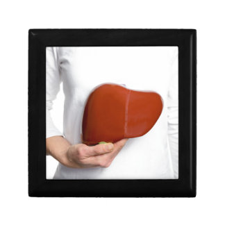 Woman holding human liver model at white body gift box