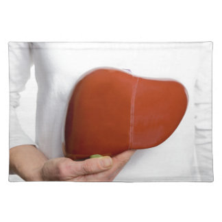 Woman holding human liver model at white body placemat