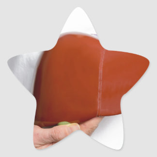 Woman holding human liver model at white body star sticker