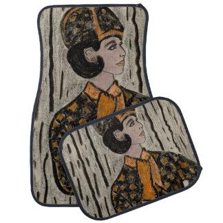 Woman in black and orange car mat