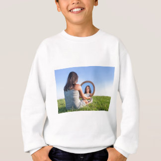 Woman in nature viewing her mirror image sweatshirt