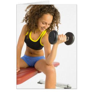 Woman lifting weights card
