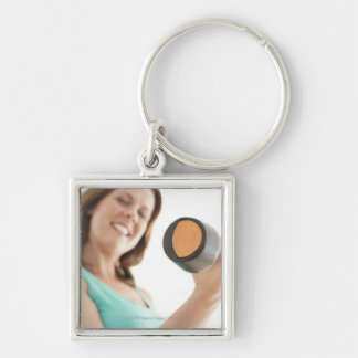 Woman lifting weights key chains