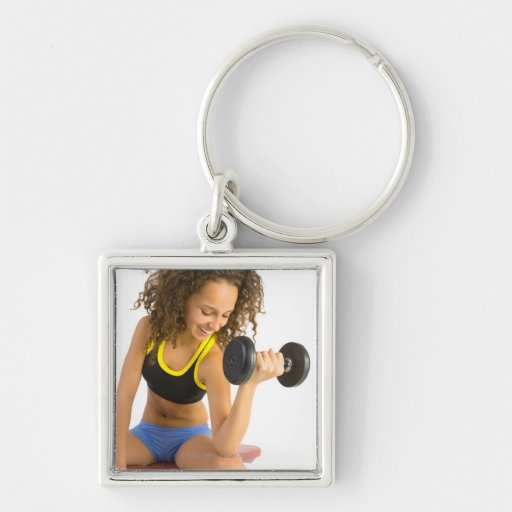 Woman lifting weights keychain