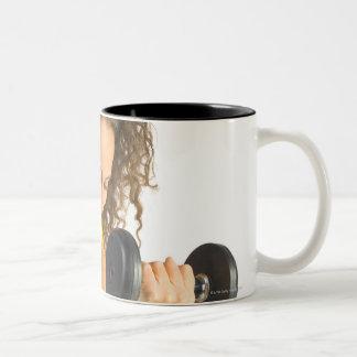 Woman lifting weights Two-Tone mug