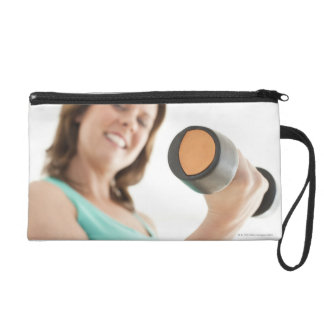 Woman lifting weights wristlet