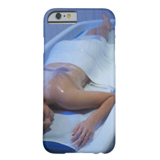 Woman lying down in vichy shower barely there iPhone 6 case