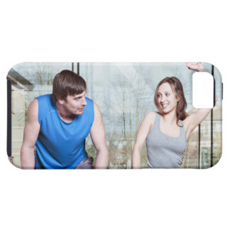 Woman on exercise bike triumphing over man iPhone 5 case