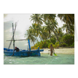 Woman on small traditional fishing boat, card