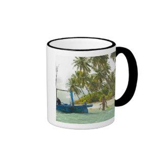 Woman on small traditional fishing boat, coffee mug