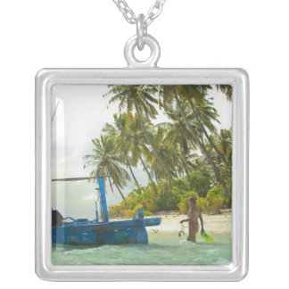 Woman on small traditional fishing boat, square pendant necklace