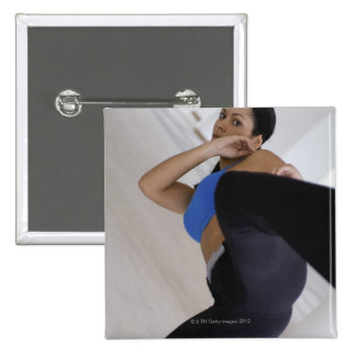 Woman performing martial arts 15 cm square badge
