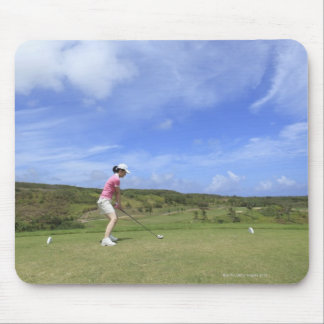 Woman playing golf mouse pad