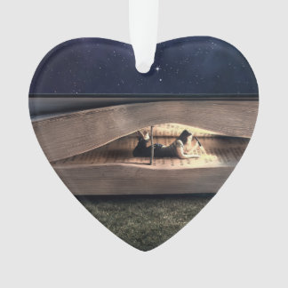Woman Reading Inside Book at Night Ornament