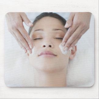 Woman receiving facial massage mouse pad