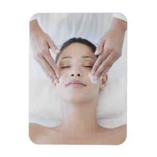 Woman receiving facial massage rectangular photo magnet