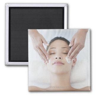 Woman receiving facial massage square magnet