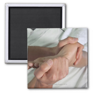 Woman receiving foot massage 2 square magnet
