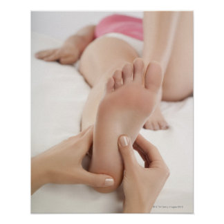 Woman Receiving Foot Massage Poster