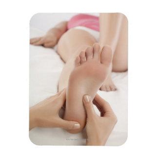 Woman receiving foot massage rectangular photo magnet