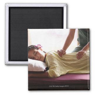 Woman receiving massage #1 square magnet