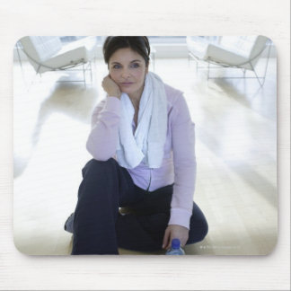 Woman resting on the floor after exercising. mouse pad
