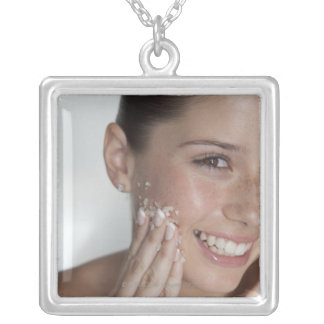 Woman scrubbing sugar on her face silver plated necklace