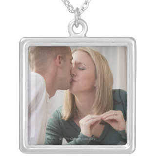 Woman signing the word 'Kiss' in American Sign Silver Plated Necklace