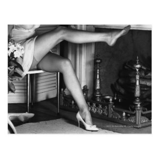 Woman sitting by fireplace B&W Postcard