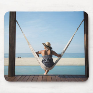 Woman Sitting On A Hammock At A Small Hotel Mouse Pad
