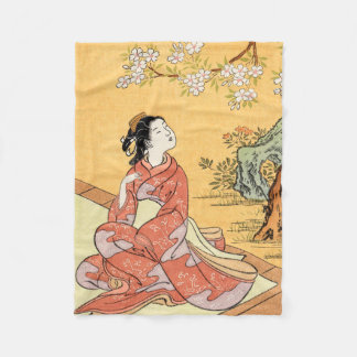 Woman Sitting Under Cherry Blossoms Fleece Blanket
