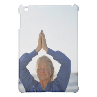 Woman standing with hands clasped overhead iPad mini cases