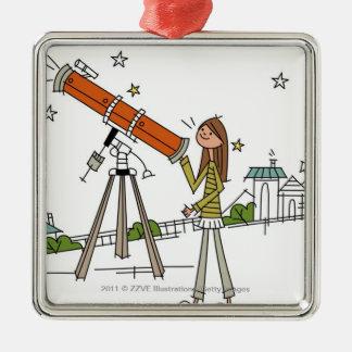 Woman using an astronomy telescope metal ornament