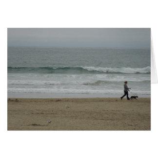 Woman Walking Dog Along Pismo Beach, CA Card
