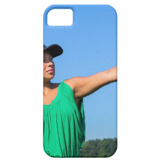 Woman with glove and cap throwing baseball outside iPhone 5 case