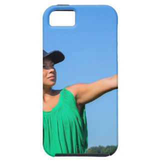 Woman with glove and cap throwing baseball outside iPhone 5 cases