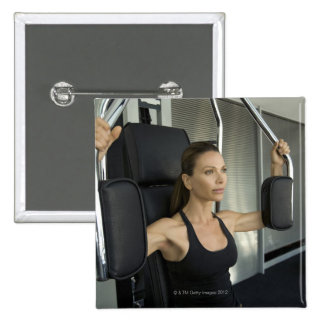 Woman working out in a gym pin