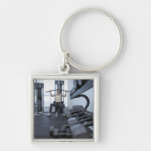 Woman working out with weights 2 keychain