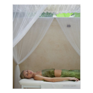 Woman wrapped in banana leaves at a spa in poster