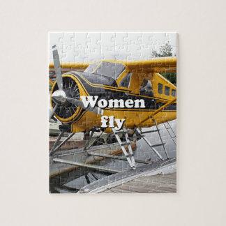 Women fly: float plane, Lake Hood, Alaska Puzzle