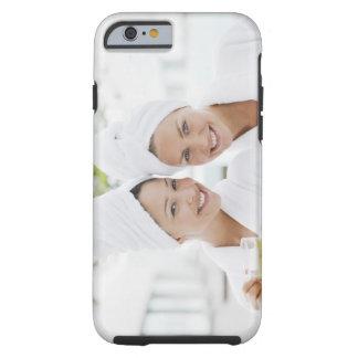 Women in bathrobes drinking tea at spa tough iPhone 6 case